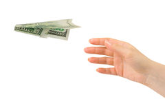 Hand and flying money plane stock photography