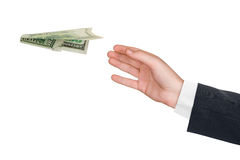 Hand and flying money plane Royalty Free Stock Photo