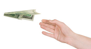 Hand and flying money plane Royalty Free Stock Images