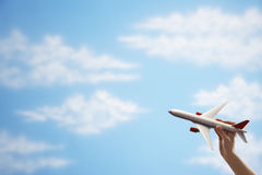 Hand Flying Toy Plane Against Sky royalty free stock image