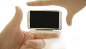 Hand focus on mobile phone concept Stock Photography