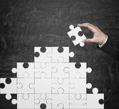 Hand folded puzzle Royalty Free Stock Images