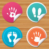 Hand and foot print icons. Imprint shoes symbol. Royalty Free Stock Photography
