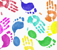 Hand and footprint montage. Multi colored finger painted hand and footprint pattern Royalty Free Stock Images