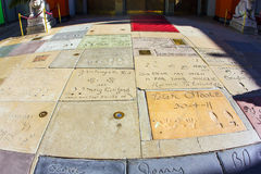Hand- and Footprints of Actors and Musicians in front of the TCL Chinese Theatre. LOS ANGELES - JUNE 26:  hand- and footprints of Artists at the Hollywood Stock Photos