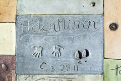 Hand- and Footprints of Helen Mirren in front of the TCL Chinese Theatre Royalty Free Stock Photography