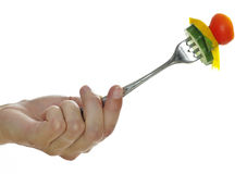 hand with fork with vegetables Stock Images