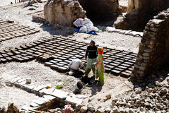 Hand formed clay bricks drying in the sun Stock Images