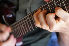 Hand forming guitar chord Royalty Free Stock Photos