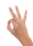 Hand forming A-OK sign. Female hand forming shape of A-OK sign; white studio background stock images