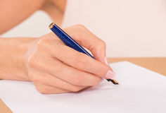 Hand with founatin pen Royalty Free Stock Photo
