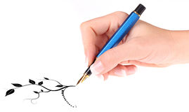 Hand with fountain pen Royalty Free Stock Photos