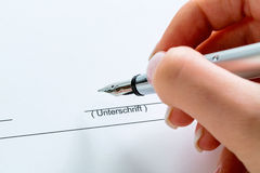 Hand with fountain pen with signature Royalty Free Stock Photo