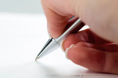Hand with fountain pen with signature Stock Photography