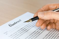 Hand with Fountain Pen Signing a Contract Royalty Free Stock Photography