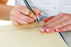 Hand with fountain pen signing contract Stock Images
