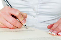 Hand with fountain pen signing contract Royalty Free Stock Photo