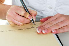 Hand with fountain pen signing contract Stock Image