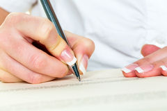 Hand with fountain pen signing contract Royalty Free Stock Images