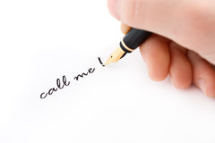 Hand and fountain pen write call me text. Hand and fountain pen writing call me text Royalty Free Stock Photos