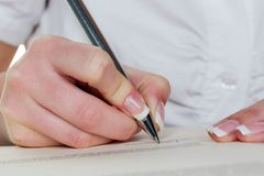 Hand with fountain pen writes under contract Stock Photos