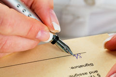 Hand with fountain pen writes under contract Royalty Free Stock Photography