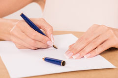 Hand with fountain pen Stock Photos