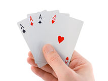 Hand and four aces Stock Photo