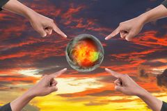 Hand four point on world hot on sky red idea global warming on sky red sunset background.  royalty free stock images