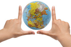 Hand framing the Globe Stock Photo