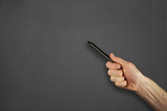 Hand in front of chalkboard Stock Photography