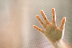 Hand on frosted glass Stock Photography