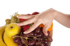 Hand on fruit plate Royalty Free Stock Image