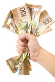 A hand full of canadian dollars Stock Images