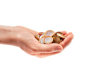 Hand full of coins Stock Images