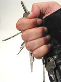 Hand full of keys. A hand holding many keys Stock Image