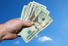 Hand full of money Stock Photos