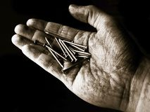 Hand Full of Nails Royalty Free Stock Photos