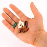 Hand Full Of Pills Stock Photography
