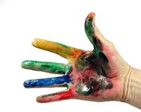 Hand full of paint. Hand with finger paint isolated over white Stock Images