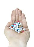 Hand full of pills Royalty Free Stock Photos