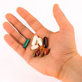 Hand Full Of Pills Stock Photography