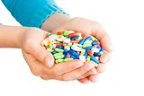 Hand full of pills Stock Photo