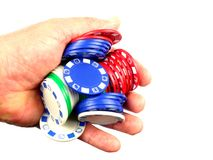 Hand full of Poker Chips. A hand grasps a pile of poker or roulette chips Stock Images