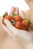 The hand full of strawberry Royalty Free Stock Images