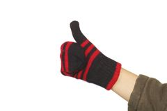 Hand with a fuzzy woolen glove Stock Photo
