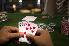 The hand of gambler play card with Human skeleton Royalty Free Stock Image