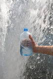 Hand gathering water Stock Images