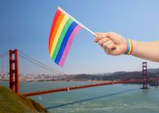 Hand with gay pride rainbow flag and wristband Royalty Free Stock Image