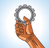 Hand and gear Stock Image